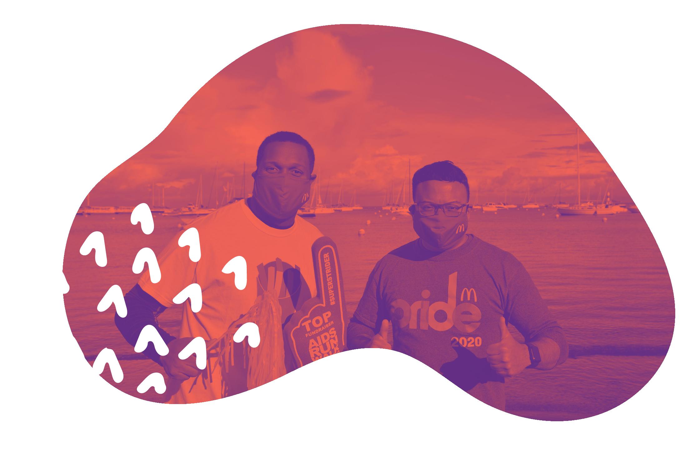 Two men wearing masks smiling at camera
